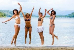 Four Women in Swimsuits Jumping