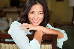 Smiling Middle Aged Woman Leaning On Chair