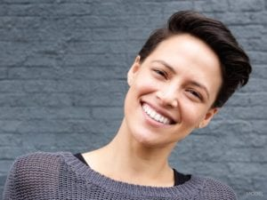 Happy Woman with Short Hair Titling Her Head to the side